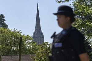 A police officer stands on duty at Queen Elizabeth Gardens in Salisbury, on July 7, 2018.