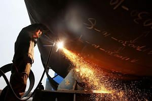 A worker welding steel in the Jiangsu province, China. The US-China trade war poses more risks to people whose livelihoods are tied to industries that face more expensive raw materials like higher steel prices.