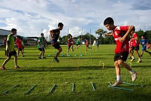 The Wild Boars football team taking part in a training session after a surprisingly smooth rescue in Mae Sai district of Chiang Rai province, on July 12, 2018.