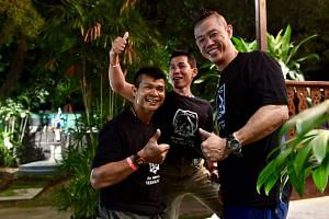 """Singaporean diver Douglas Yeo (right) with Thai navy Seal """"Joe"""" (left), who was his buddy during the rescue operation, and another Thai navy Seal, who was the supervisor of the site where they were deployed inside the cave. Mr Yeo is the only kno"""