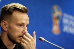 Croatia's player Ivan Rakitic attends a press conference in Moscow.