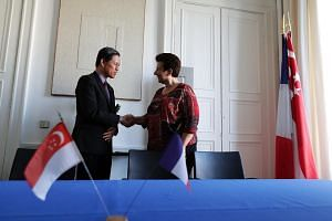 Minister for Trade and Industry, Chan Chun Sing (left) and French Minister of Higher Education, Research and Innovation Dr Frédérique Vidal shaking hands in Paris, on July 13, 2018. Singapore can learn much from the French, and use the French netwo