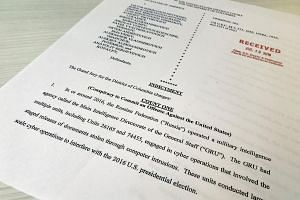 A copy of the grand jury indictment against 12 Russian intelligence officers is seen after the indictments were filed in US District Court by prosecutors working as part of special counsel Robert Mueller's Russia investigation in Washington, on July