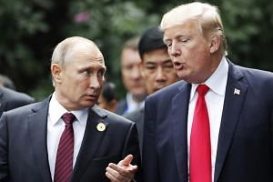 US President Donald Trump (right) and Russia's President Vladimir Putin meeting on the sidelines of an APEC meeting in Da Nang, Vietnam, on Nov, 2017.