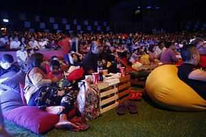 Fans watching the live screening of a match in comfort at the Resorts World Sentosa's Football Fever event.