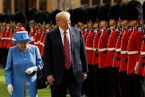 Trump and Britain's Queen Elizabeth II inspect the guard of honour at Windsor Castle on the second day of Trump's UK visit.