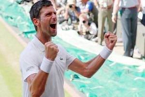 Serbia's Novak Djokovic celebrates winning the men's singles final against South Africa's Kevin Anderson (not pictured) in the All England Lawn Tennis and Croquet Club, London, Britain, on July 15, 2018.