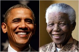 "Former US President Barack Obama (left) met Nelson Mandela only briefly in 2005, but hailed him as ""the last great liberator of the 20th century""."