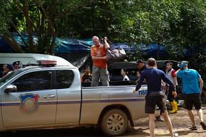 British caver Vernon Unsworth (centre) gets out of a vehicle near the Tham Luang cave complex, where 12 boys and their soccer coach were trapped, in the northern province of Chiang Rai, Thailand, on July 5, 2018.