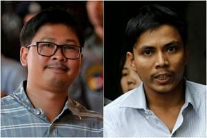 Journalists Wa Lone (left) and Kyaw Soe Oo were charged with breaching the colonial-era Official Secrets Act and face up to 14 years in prison.