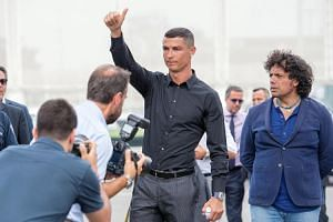 New Juventus soccer player Cristiano Ronaldo of Portugal arrives for a press conference at the new Juventus headquarters in Via Druento in Turin, Italy, on July 16, 2018.