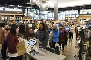 Shoppers at an Amazon bookstore in Washington, US.The retailer directly sells some books, while others are sold by third parties like booksellers who mark the price of books online to four figures.