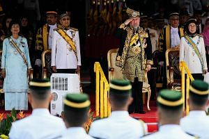 Above: Malaysia's King, Sultan Muhammad V, taking the salute at the opening of Malaysia's new Parliament in Kuala Lumpur, flanked by Prime Minister Mahathir Mohamad and Deputy Prime Minister Wan Azizah Wan Ismail. Beside Tun Dr Mahathir is his wife S