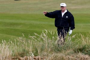 US President Donald Trump on the course of his golf resort, in Turnberry, Scotland, on July 14, 2018.  He resigned as a director of Turnberry when he took office, but still holds an ownership stake.
