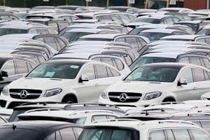 Cars of German car maker Mercedes Benz are parked at the automotive terminal at the port of Bremerhaven, northern Germany, on July 23, 2017.