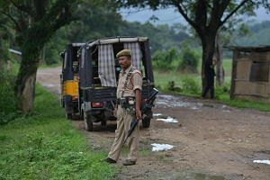 Security personnel near the site of the lynching of two men in Assam, India, on July 10, 2018. They were beaten to death by a mob after rumours of them being child abductors were circulated on WhatsApp.