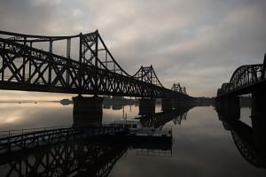 The Friendship bridge connecting the North Korean town of Sinuiju and the Chinese border city of Dandong. Trucks ply the bridge to bring goods from China into North Korea.