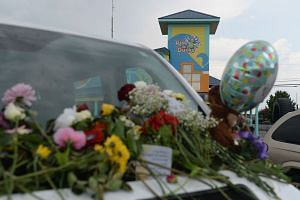 Cards and flowers are seen on the vehicle of one of the victims of the Ride The Ducks accident.