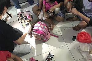 A four-year-old girl sitting on the lap of her mother who was busy getting high - that was the scene when CNB officers raided a one-room flat in Chin Swee Road last month.