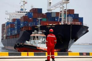 File photo of a port worker watching a ship leaving the New Priok Container in North Jakarta, Indonesia. The Generalised Systems Preferences led to tariff cuts for US$1.8 billion worth of Indonesian products in 2016.