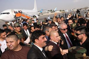 Afghan exiled voice president, Abdul Rashid Dustom (third from right) among his supporters as he arrives at the Hamid Karzai international airport, Kabul, Afghanistan, on July 22, 2018.