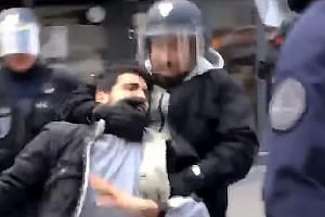 Alexandre Benalla was filmed wearing a police visor and beating a protester.