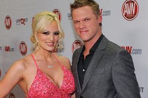 Adult film actress Stormy Daniels (left) and her husband, adult film actor Brendon Miller, at the 29th annual Adult Video News Awards Show at the Hard Rock Hotel & Casino, on Jan 21, 2012 in Las Vegas, Nevada.