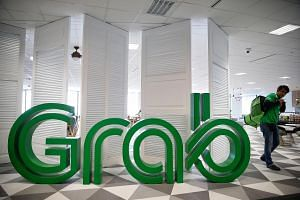 Customers sparking an online furore when they discovered they were earning fewer points per dollar spent on transport when ride-hailing firm Grab revises its GrabRewards policy.