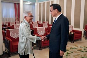 Malaysia's new government adviser Daim Zainuddin meeting Chinese Premier Li Keqiang in Beijing last week. The extent of the cull and restructuring overseen by Tun Daim, who leads the five-man Council of Eminent Persons, has led to a pushback from r