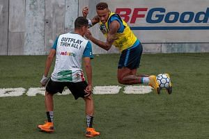 Brazil star Neymar, who is on an extended break after the World Cup, enjoying himself as he hosted a five-a-side tournament for his charity Neymar Junior Project Institute in Praia Grande, Sao Paulo, Brazil, last Saturday.