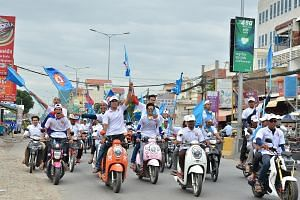 Cambodian People's Party supporters at a rally in Phnom Penh on Sunday. The party had thousands tooting their horns and waving the blue CPP flag in endless convoys of trucks, tuk-tuks and motorcycles.