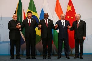 (From left) India's Prime Minister Narendra Modi, China's President Xi Jinping, South Africa's President Cyril Ramaphosa, Russia's President Vladimir Putin and Brazil's President Michel Temer pose for a group picture.