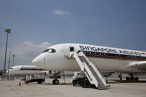 Operating profit for Singapore Airlines' parent airline roughly halved from $370 million to $181 million in the absence of one-off items.