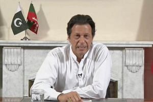 While former cricket hero Imran Khan was likely to fall short of the 137 seats needed for a majority in the National Assembly, his unexpected results should allow him to form a government with a handful of small coalition partners.