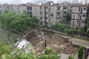 A road that collapsed following heavy rain in Ghaziabad, Uttar Pradesh state, India, on July 26, 2018.