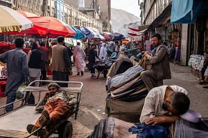 Street stall vendors wait for customers at the Mandai Bazaar in Central Kabul, Afghanistan.