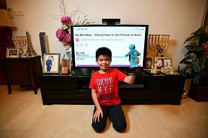 Primary 2 student David Jap, seen here at home, set up a crowdfunding page on Giving.sg to raise funds for the Straits Times School Pocket Money Fund, which has raised more than $1,700. Crowdfunding has taken off here in a big way in the past few yea