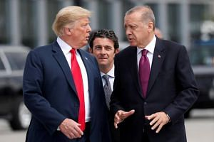 """File photo showing US President Donald Trump (left) and Turkish President Tayyip Erdogan, who warned that US sanctions will not force Ankara to """"step back""""."""