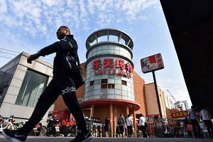 Sales at Lotte's China department business fell 22 per cent to 76 billion won (S$92.83 million) in 2017, resulting in 70 billion won in operating losses.