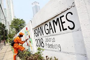 Helping Jakarta make a good impression is an army of sanitation workers known locally as Pasukan Oranye, or the Orange Force, so called because of the colour of their uniforms and vehicles. Pasukan Oranye workers cleaning Lake Sunter in North Jakarta