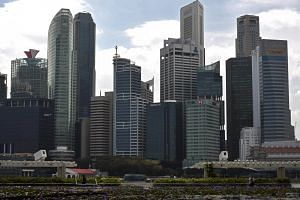 Singapore's central business district. Women in the very top corporate jobs will encourage female board numbers to soar, according to the Women In The Boardroom report.