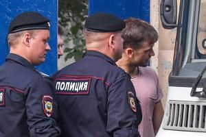 The Pussy Riot punk group member Pyotr Verzilov (right) leaves a detention centre in Moscow on July 30, 2018.