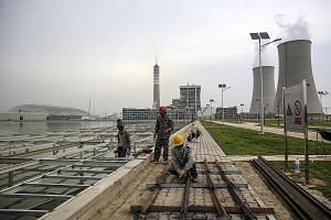 Construction at the Chinese-owned Sahiwal coal power plant in Pakistan's Punjab province last year. The trilateral partnership between Australia, the US and Japan seeks to counter China's efforts to court influence in the Indo-Pacific region.