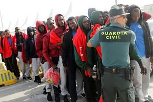 Migrants being stopped by a Spanish Civil Guard in Spain, where the number of refugee arrivals is currently running at more than three times the levels in the comparable period last year.