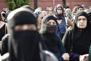 Women protest in Copenhagen on the first day of the implementation of the Danish face veil ban.