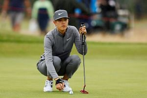 Wie lines up a putt during the first round of the Women's British Open.