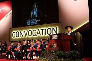 Minister for Social and Family Development Desmond Lee addressing graduates of Nanyang Technological University's School of Social Sciences at their convocation ceremony yesterday, where he announced the setting up of social service hubs.