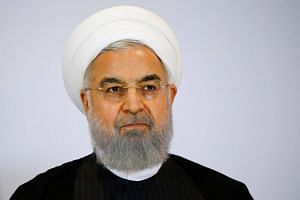 It is the first time Parliament has summoned President Hassan Rouhani, who is under pressure from hardline rivals to change his Cabinet following a deterioration in relations with the US.