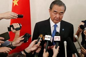 China's Foreign Minister Wang Yi speaks to the media after bilateral meetings on the sidelines of the Asean Foreign Ministers' Meeting in Singapore, on Aug 2, 2018.