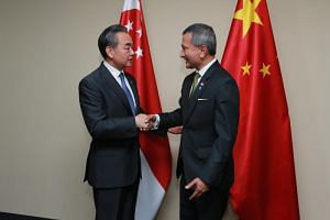China's Foreign Minister Wang Yi (left) called on his Singapore counterpart Vivian Balakrishnan on Aug 1, 2018.